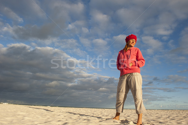 Pretty woman standing lonely at beach Stock photo © roboriginal