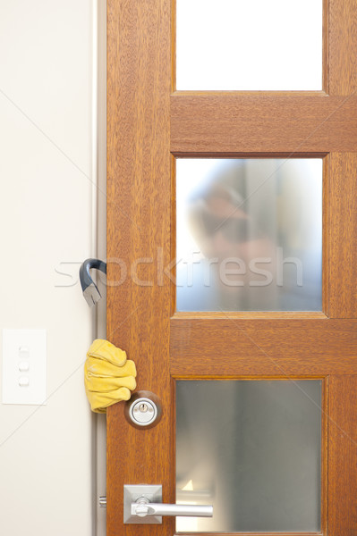 Thief breaking in house with crowbar Stock photo © roboriginal