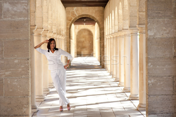 Confident happy mature woman historic archway Stock photo © roboriginal