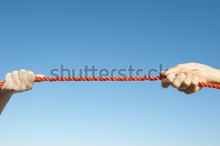 Stock fotó: Kezek · kötél · égbolt · körül · narancs · húz