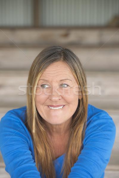 Félénk mosolygó nő portré vonzó érett nő arckifejezés Stock fotó © roboriginal