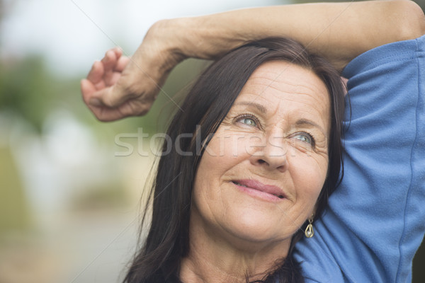 Happy smiling relaxed mature woman Stock photo © roboriginal