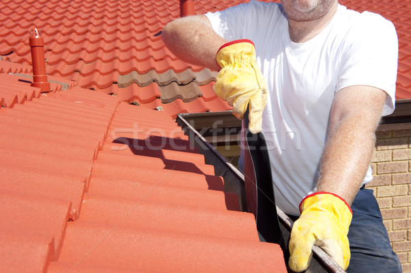 Seasonal Gutter cleaning red roof Stock photo © roboriginal