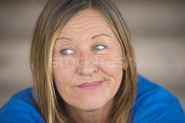 Cheeky smiling woman portrait Stock photo © roboriginal