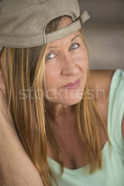 Confident thoughtful sporty mature woman cap Stock photo © roboriginal