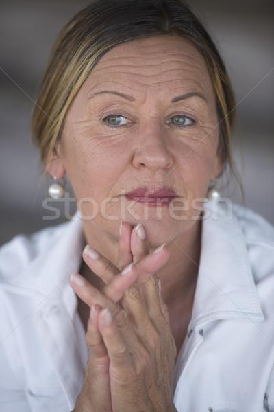 Confident serious mature woman portrait Stock photo © roboriginal