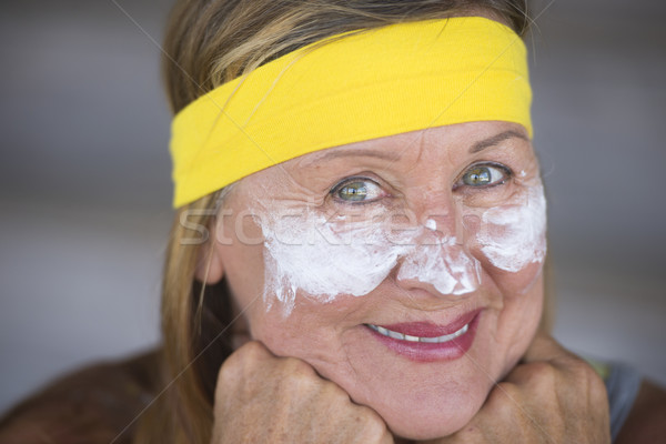 Confident mature woman facial creme portrait Stock photo © roboriginal