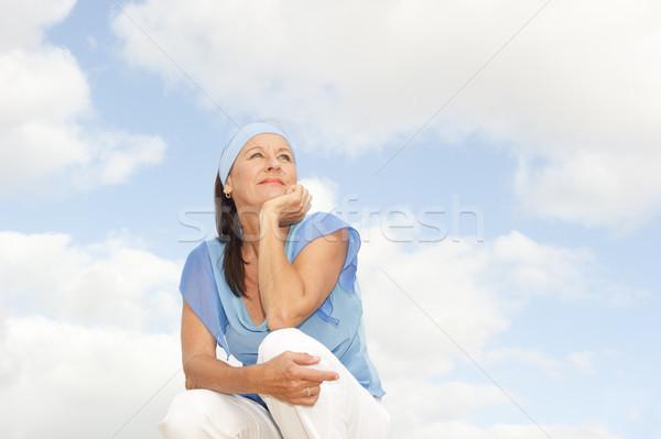 Boldog figyelmes középkorú nő szabadtér portré nyugodt Stock fotó © roboriginal