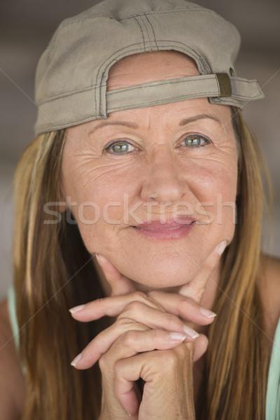 Active fit happy mature woman sporty cap Stock photo © roboriginal