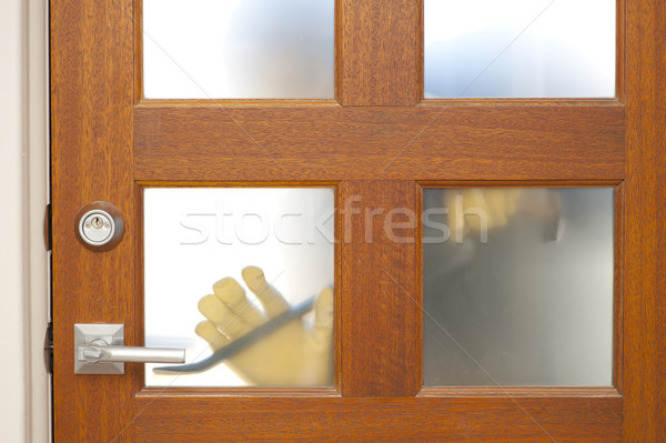 Burglar housebreaking security door Stock photo © roboriginal