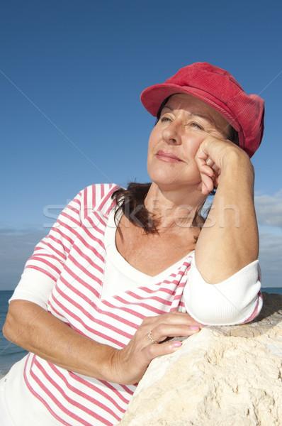 Relaxed attractive mature woman outdoor Stock photo © roboriginal