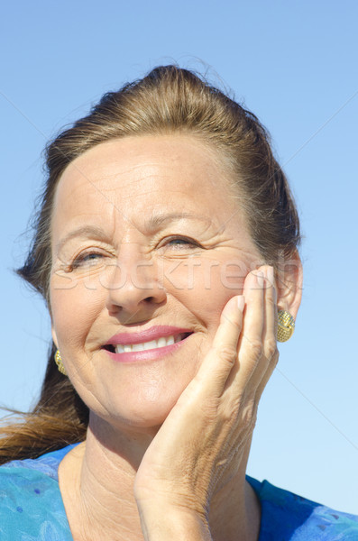 Portrait attractive mature woman isolated sky Stock photo © roboriginal