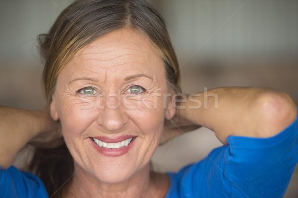 Happy confident senior woman portrait Stock photo © roboriginal