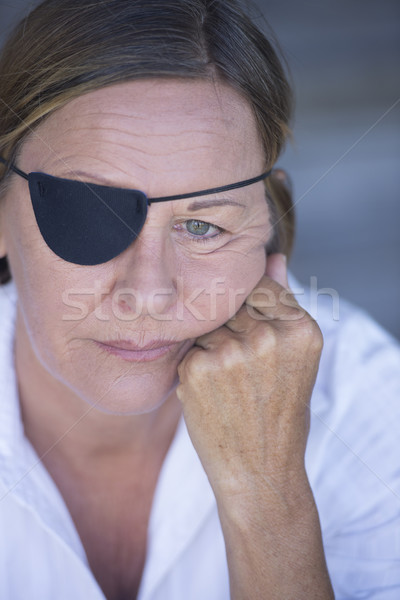 Depressed woman with eye patch portrait Stock photo © roboriginal