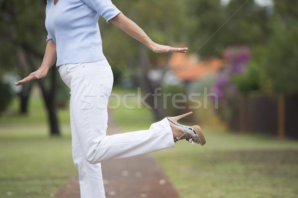 Yüksek topuklu dengeleme kadın açık beyaz pantolon Stok fotoğraf © roboriginal