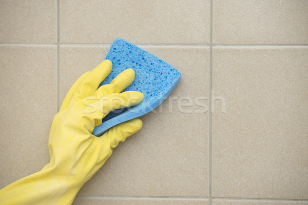 House cleaning of floor tiles with sponge Stock photo © roboriginal