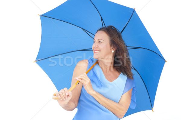 Stockfoto: Aantrekkelijk · rijpe · vrouw · Blauw · paraplu · portret · permanente
