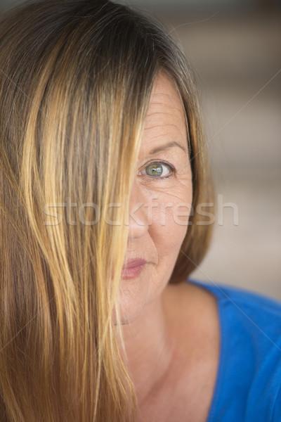 Happy woman hair covering face portrait Stock photo © roboriginal