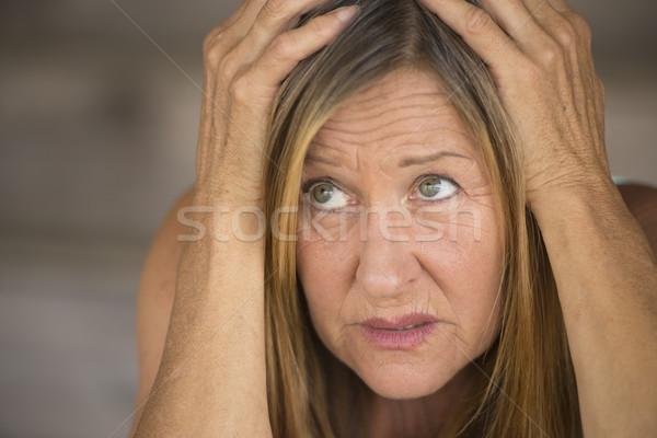 Nyugtalan nő kezek fej portré vonzó Stock fotó © roboriginal
