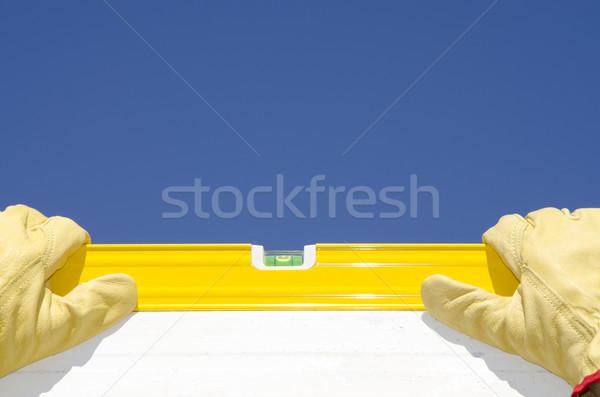 Hands construction worker with spirit level Stock photo © roboriginal