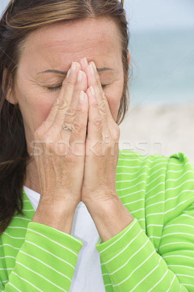 Sad Woman in grief and sorrow praying hands Stock photo © roboriginal