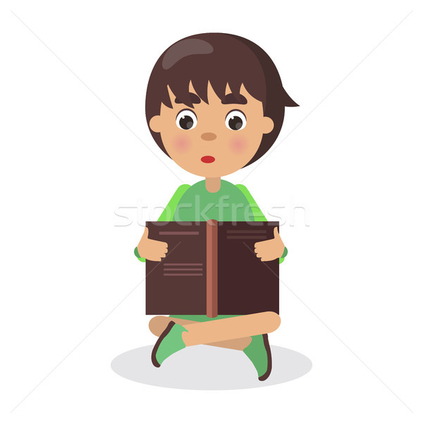 Boy Sits in Yoga Pose with Open Book and Read Stock photo © robuart
