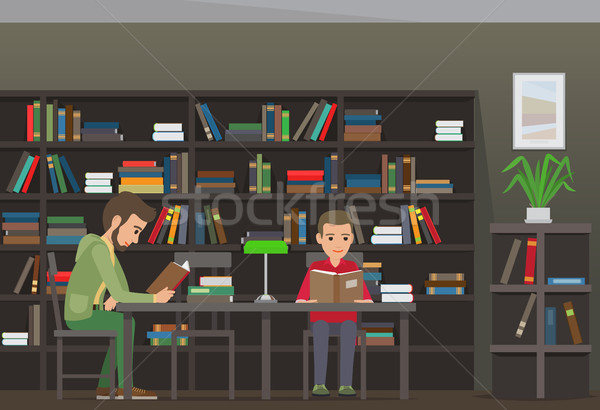 Two Boys Sit at Table and Read Books in Library Stock photo © robuart