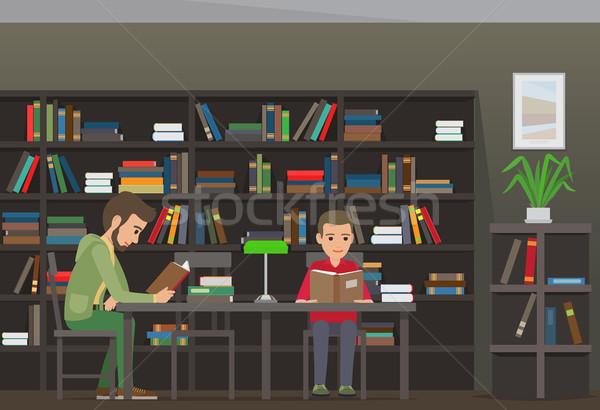 Iki erkek oturmak tablo okumak kitaplar Stok fotoğraf © robuart