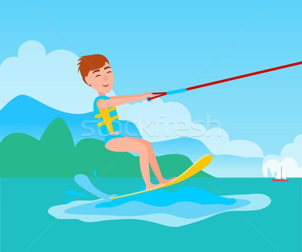Kitesurfing and Happy Boy Vector Kitesurfer on Ski Stock photo © robuart