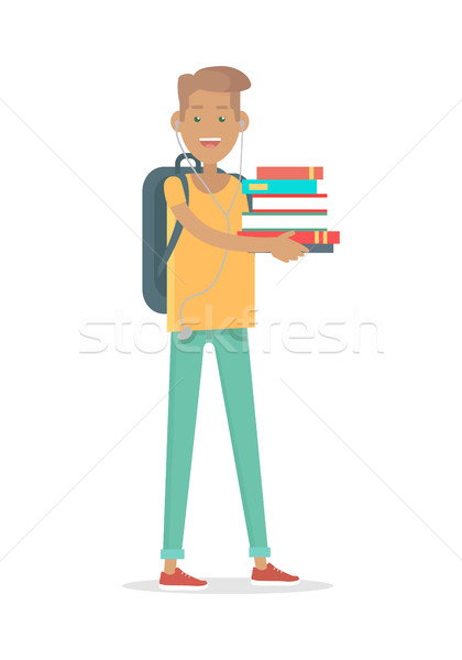 Young Man Student in Earphones with Rucksack Stock photo © robuart