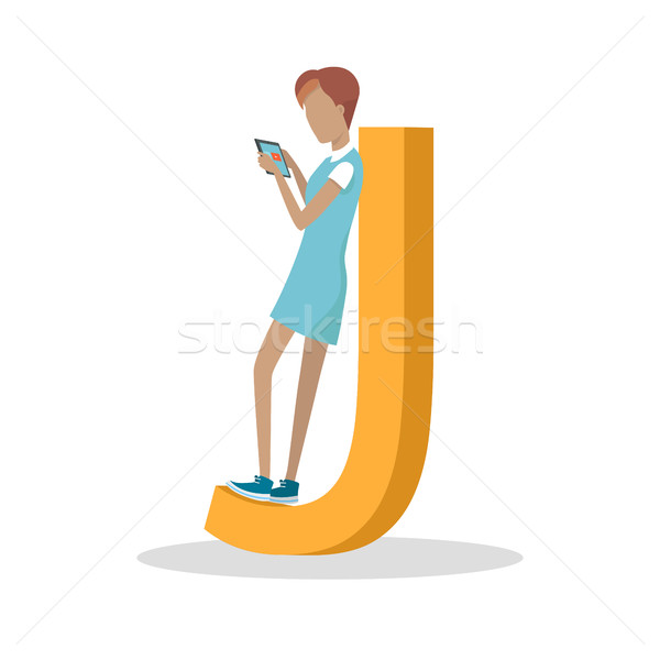 J Letter and Girl Standing and Playing on Tablet Stock photo © robuart
