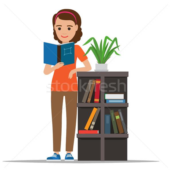 Kobieta czytania podręcznik biblioteki wektora kobiet Zdjęcia stock © robuart