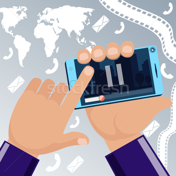 Man holding smartphone in hand and watching movie video Stock photo © robuart