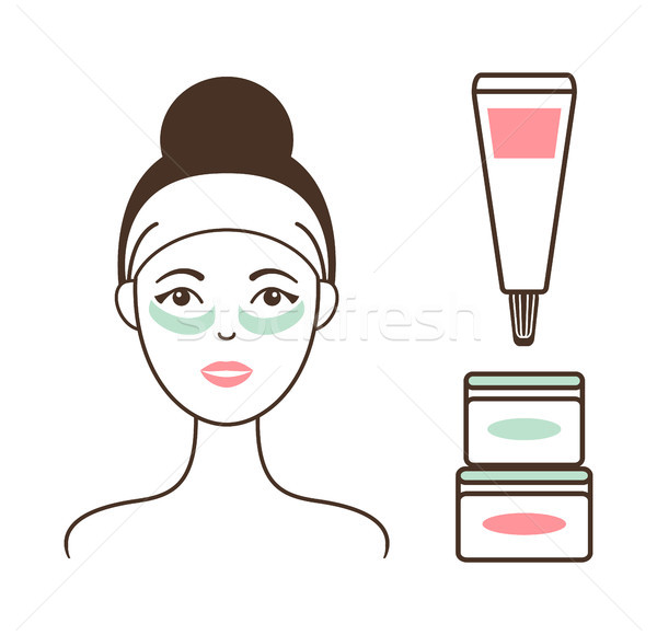 Woman in Headband with Tender Cream Under Eyes Stock photo © robuart