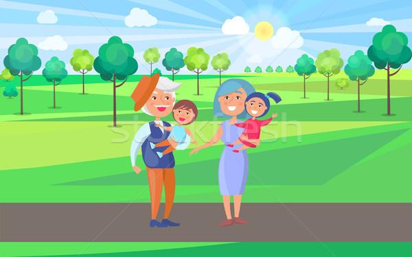 счастливым дедушка и бабушка детей стороны Сток-фото © robuart