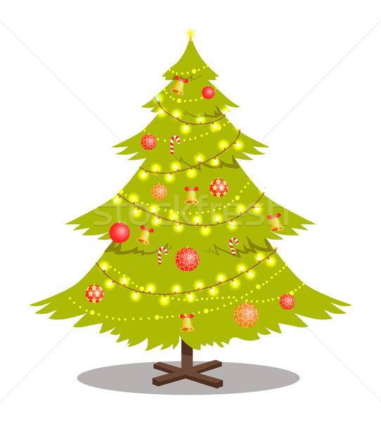 Nouvelle année arbre décoré éclairage or bonbons Photo stock © robuart