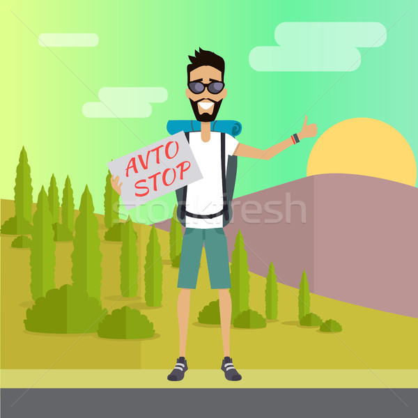 Smiling Young Man Hitchhiking Stock photo © robuart