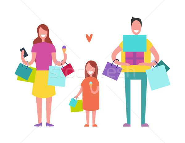 ストックフォト: 笑みを浮かべて · 家族 · ショッピング · 父 · 母親 · 娘