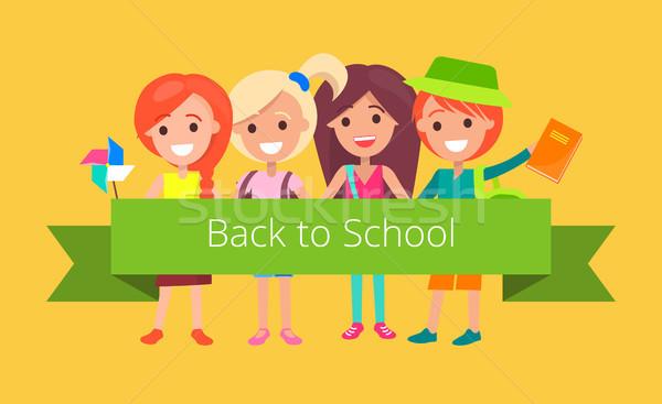 Iskolás jó hangulat kész vissza az iskolába tart zöld Stock fotó © robuart