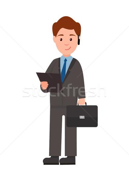 Affaires portable affiche permanent souriant serviette Photo stock © robuart