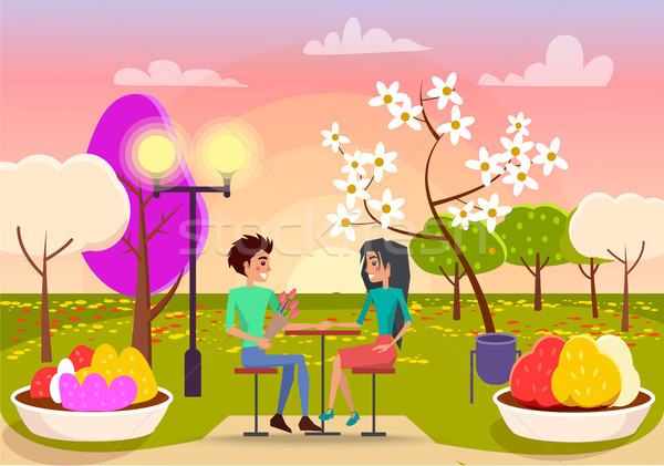 Couple in Love Sits at Table on Sunset in Park Stock photo © robuart