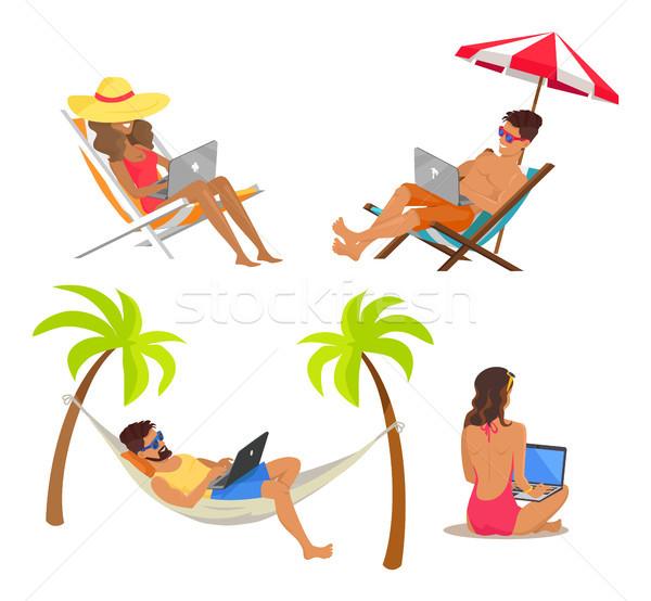 Blijde mensen werken afgelegen laptops Stockfoto © robuart