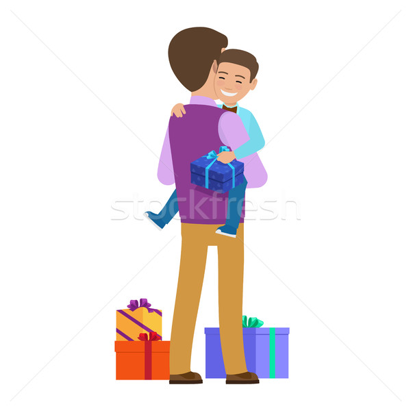 Smiling Small Boy with Gift Box on Father s Hands Stock photo © robuart