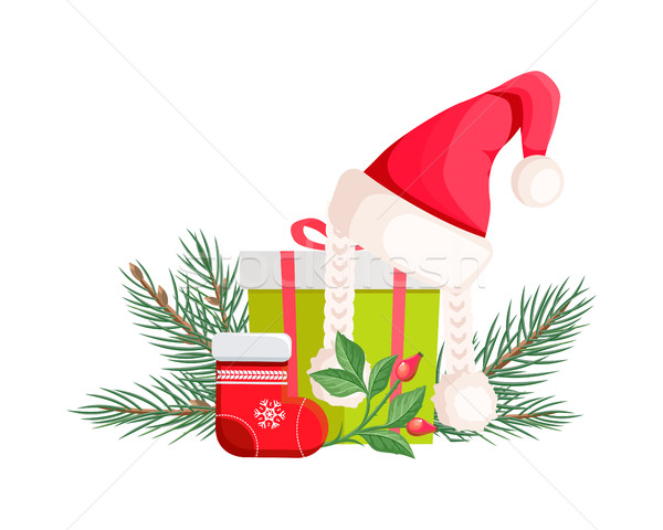 Santa Claus Hat Lying on Gift Bow with Red Ribbon Stock photo © robuart