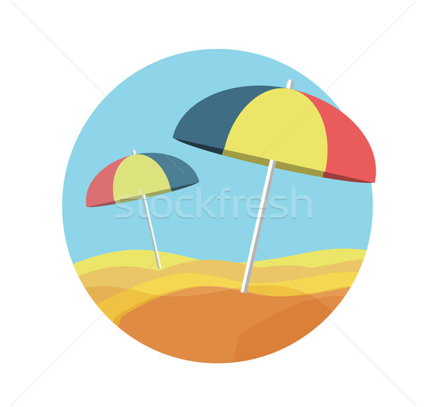 Beach umbrellas on a deserted beach Stock photo © robuart