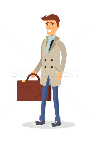 Stock photo: Man in Coat with Brown Suitcase Isolated on White