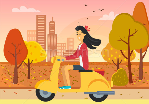 Woman Driving Scooter in Autumn City Park Stock photo © robuart