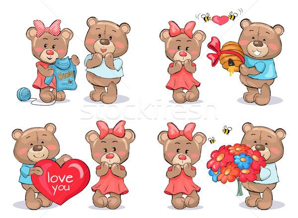 Aanbiddelijk teddyberen paren uitwisseling presenteert vrouwelijke Stockfoto © robuart