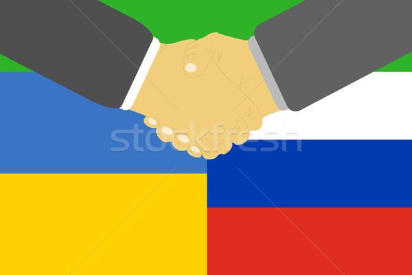 Russia Ucraina crisi amicizia bandiere stretta di mano Foto d'archivio © robuart