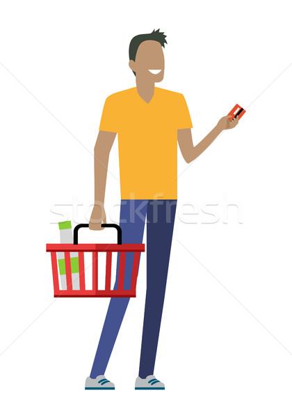 Férfi bevásárlókosár mosolyog citromsárga póló kék Stock fotó © robuart
